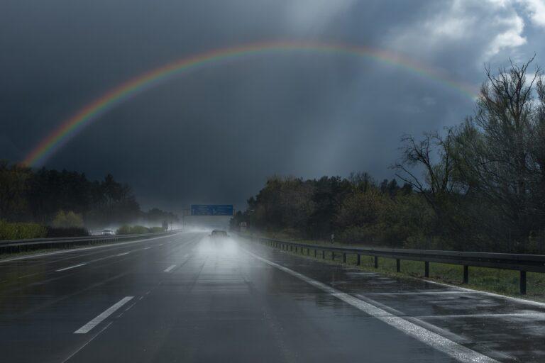car driving rainbow
