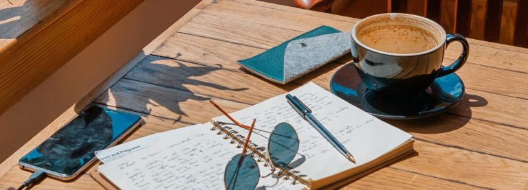 Business woman uses journaling to find mindfulness and meaningful work