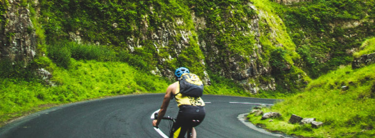 cyclist on a mountain road as an analogy for the diminishing return of determination